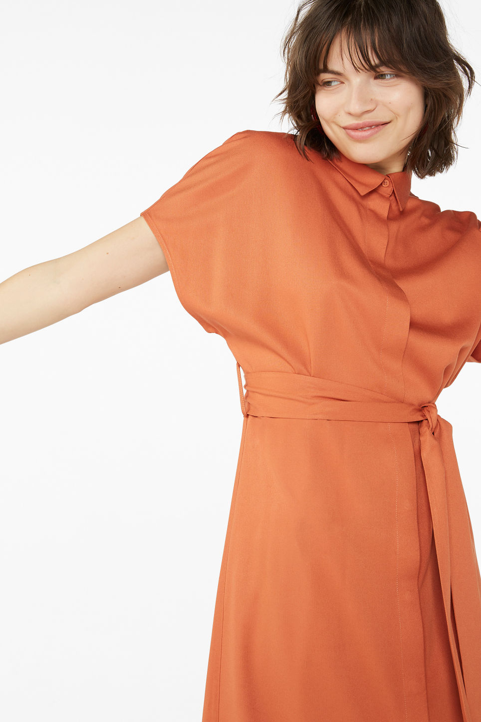Model front image of Monki belted hidden button shirt dress in orange