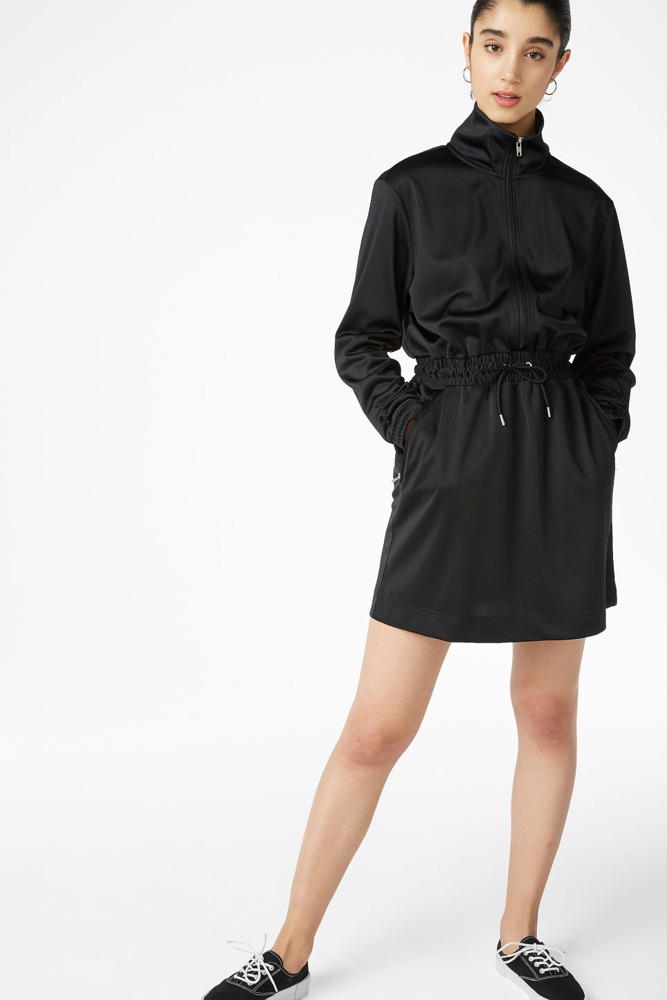 Model side image of Monki sporty drawstring dress in black
