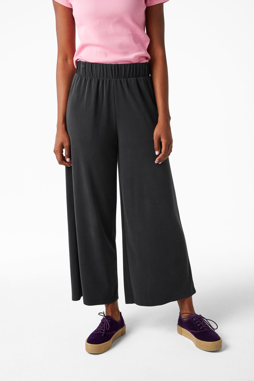 Model front image of Monki super-soft wide leg trousers in black