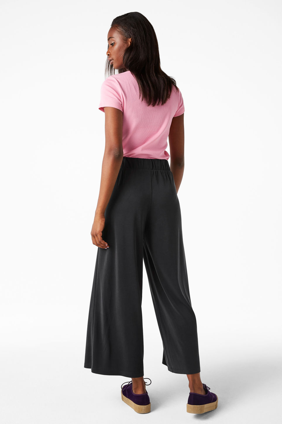 Model side image of Monki super-soft wide leg trousers in black