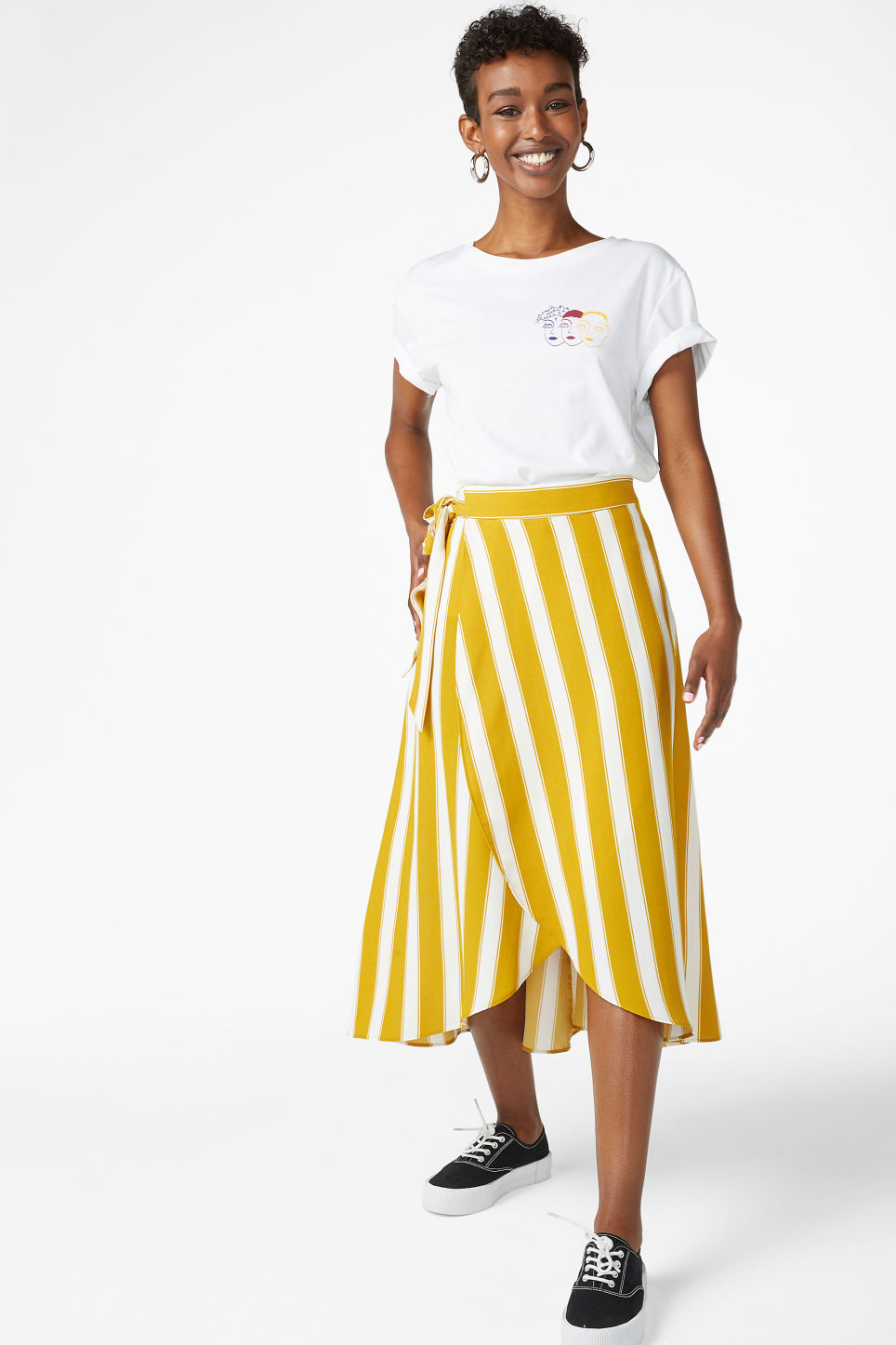 Model front image of Monki wrap front skirt in yellow