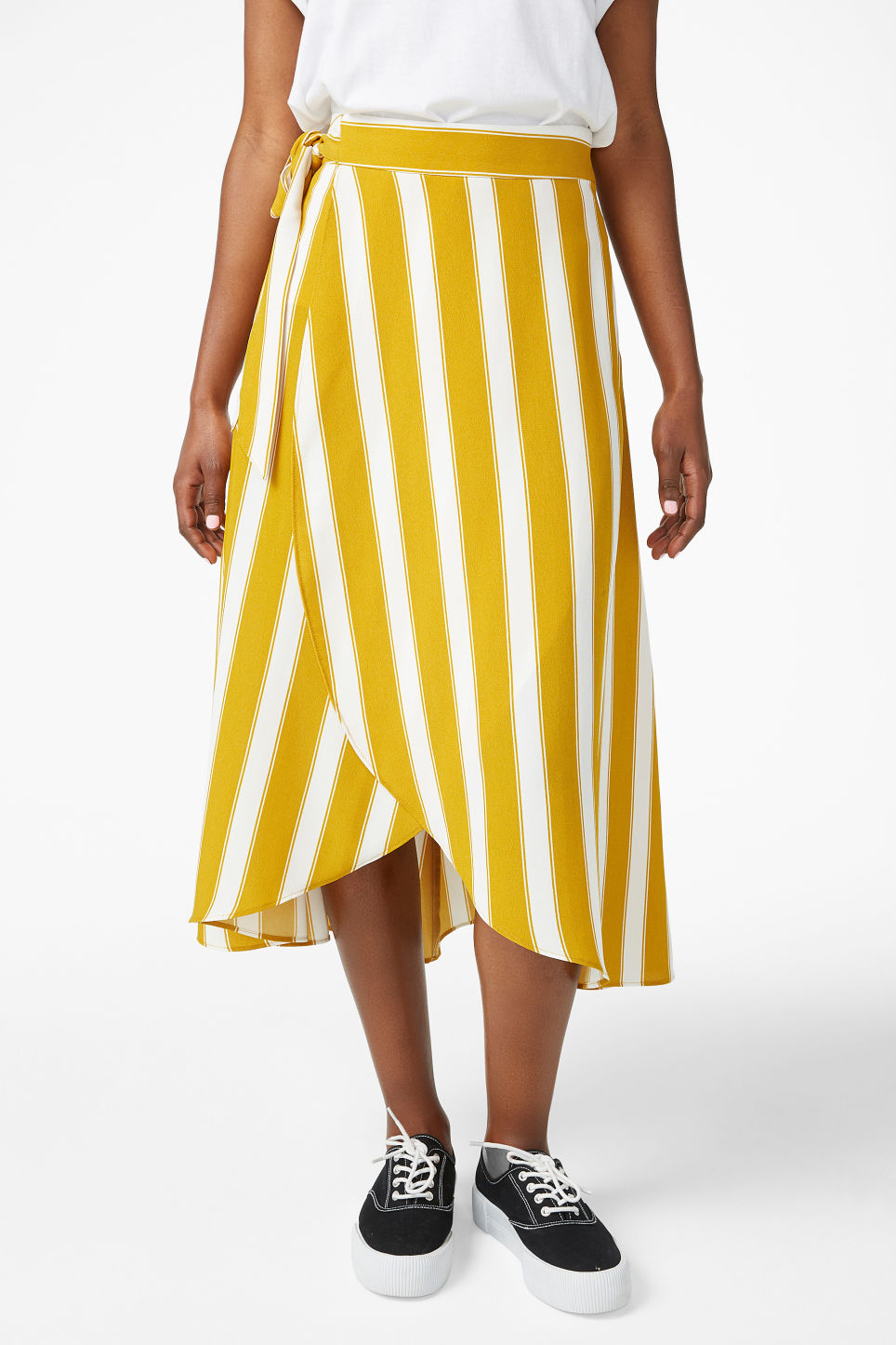 Model side image of Monki wrap front skirt in yellow