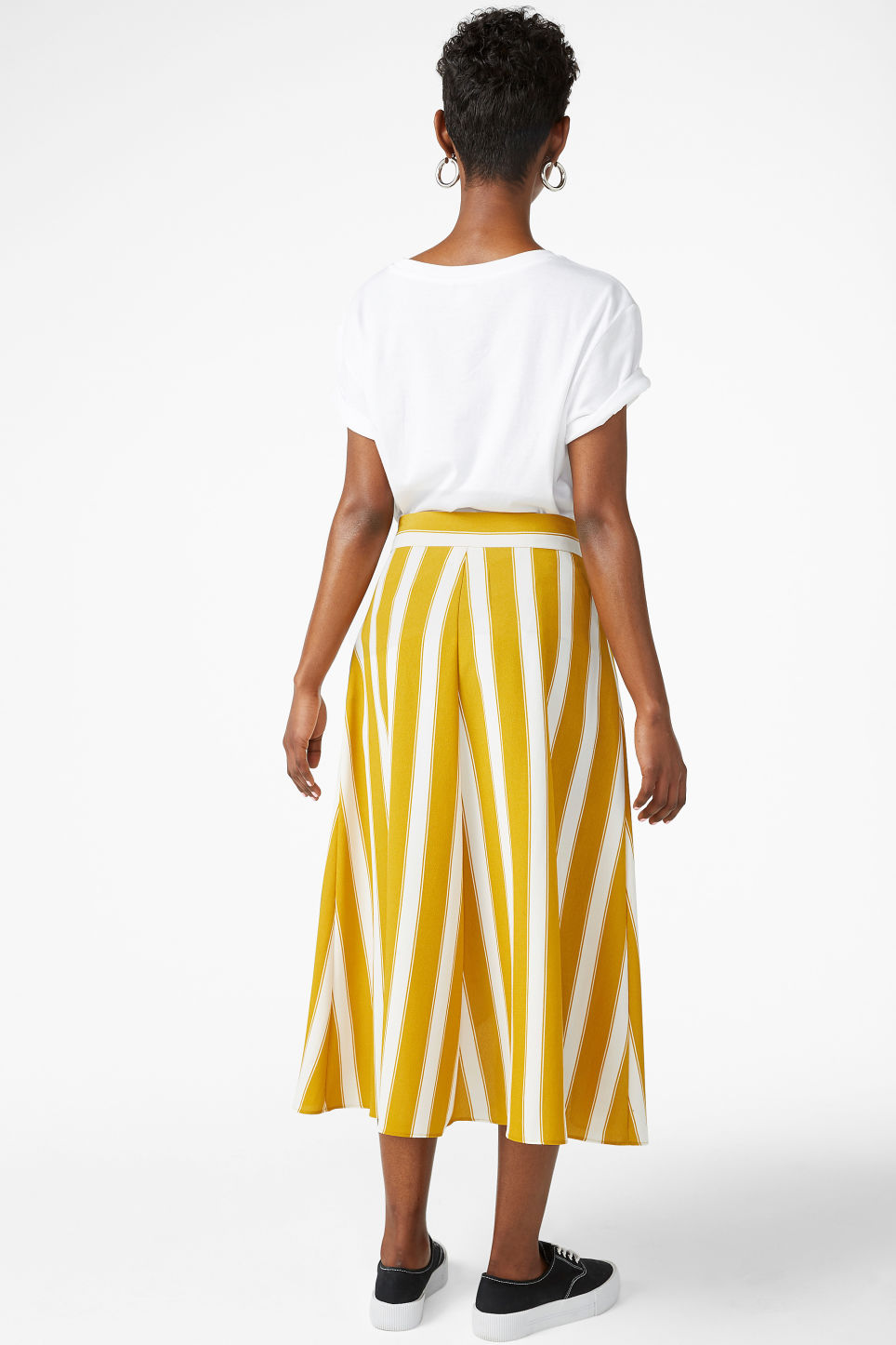 Model back image of Monki wrap front skirt in yellow