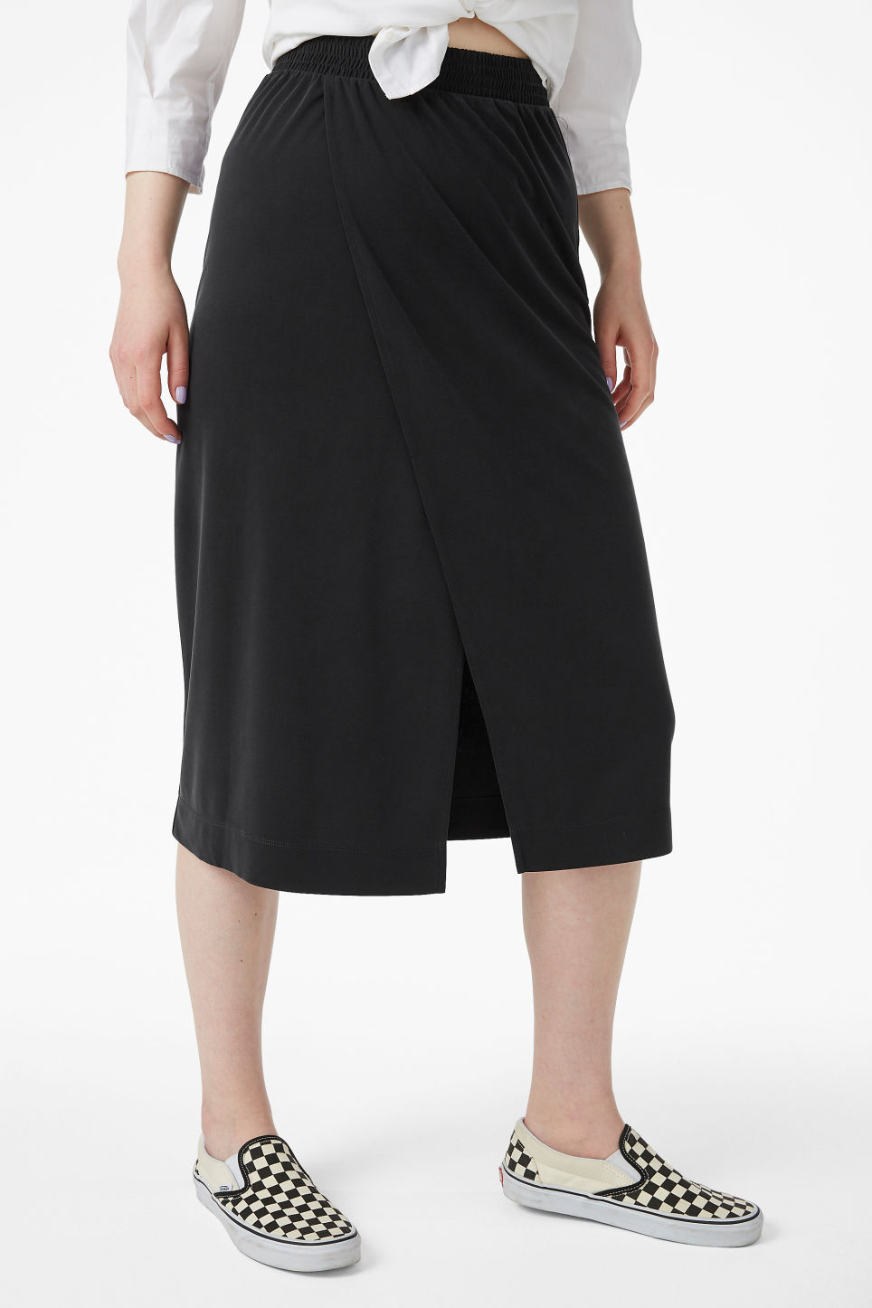 Model side image of Monki super-soft wrap skirt in black