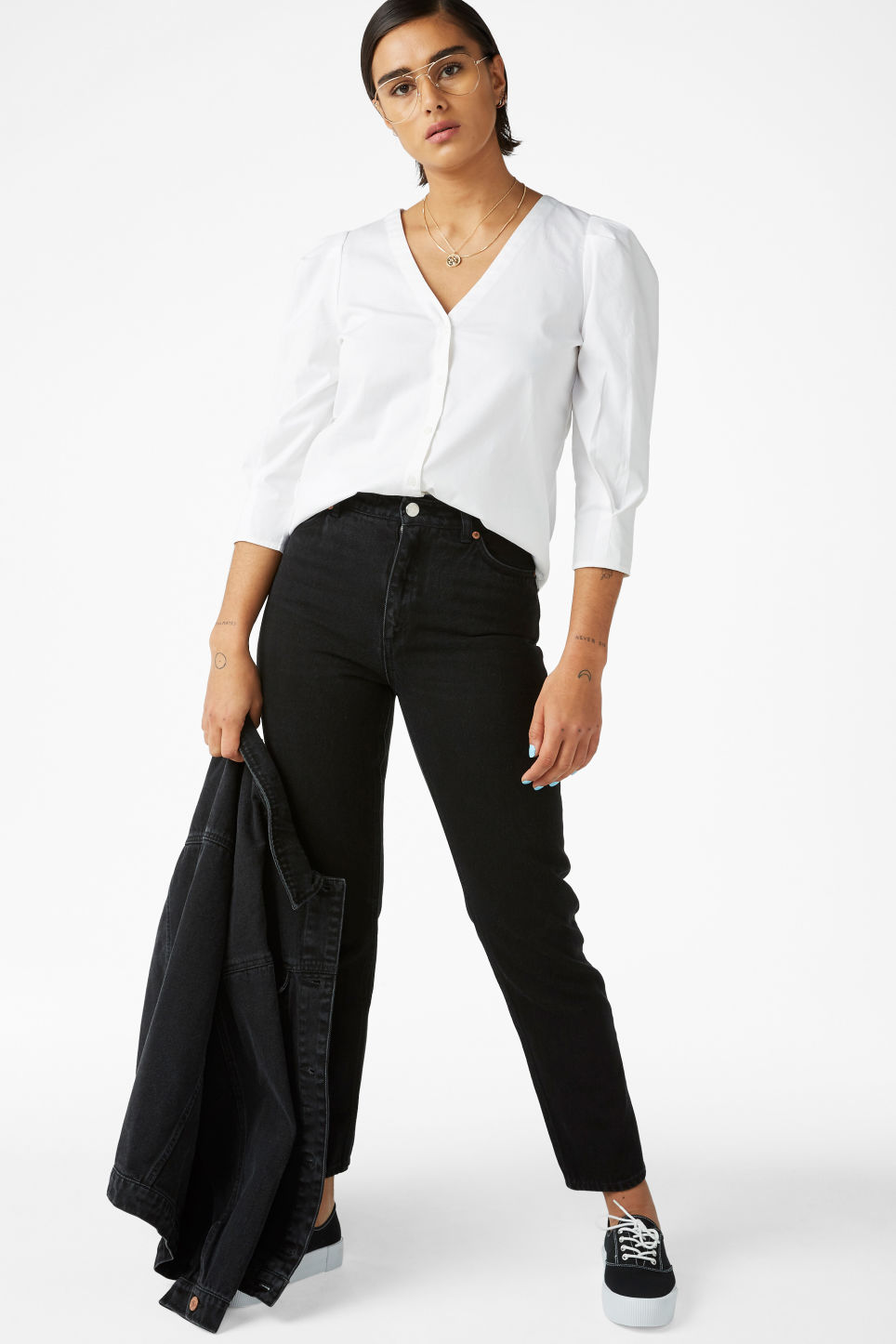 Model front image of Monki v-neck blouse in white