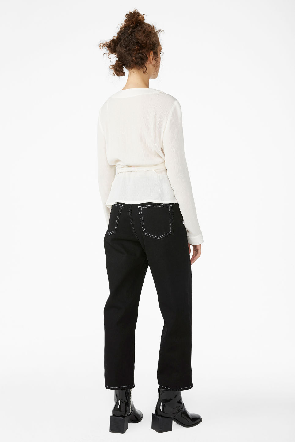 Model back image of Monki wrap blouse in white