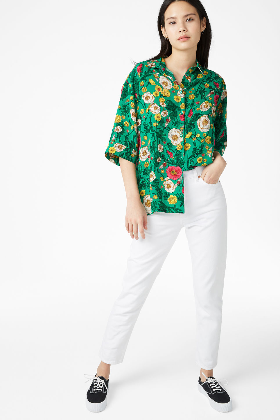 Model side image of Monki oversized blouse in green