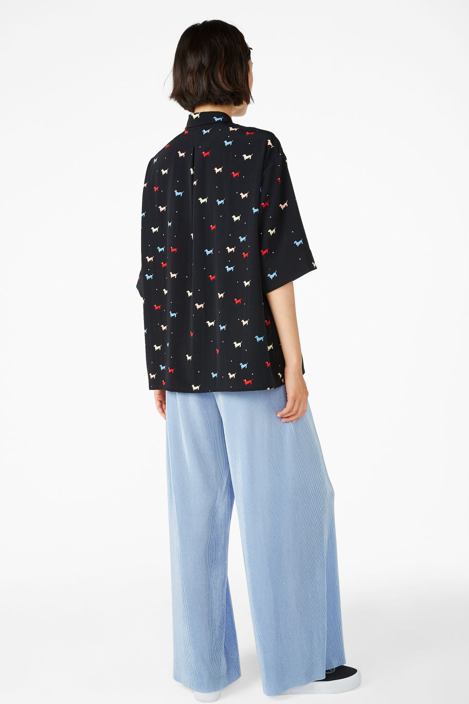 Model back image of Monki flowy button-up shirt in black