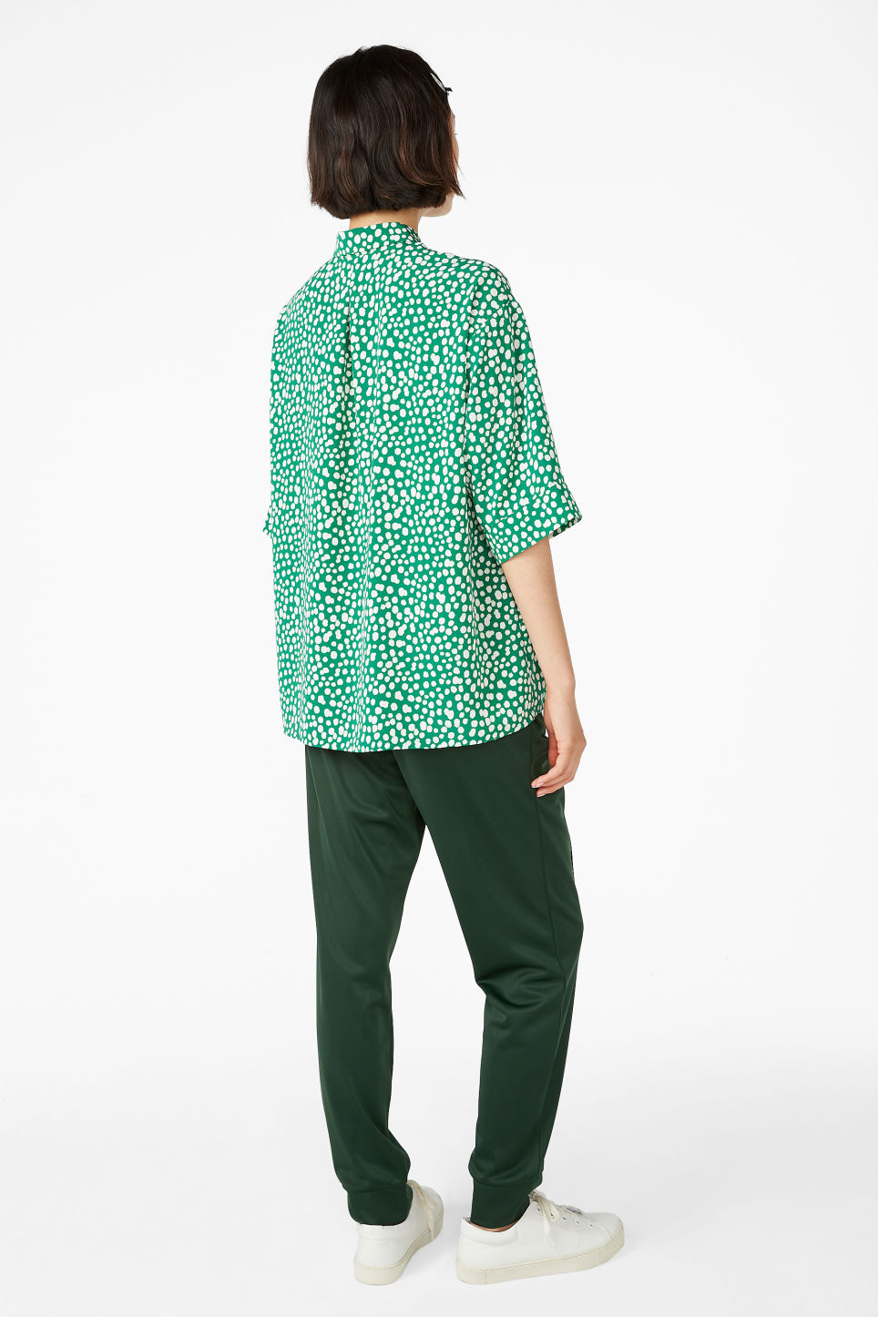 Model back image of Monki flowy button-up shirt in green