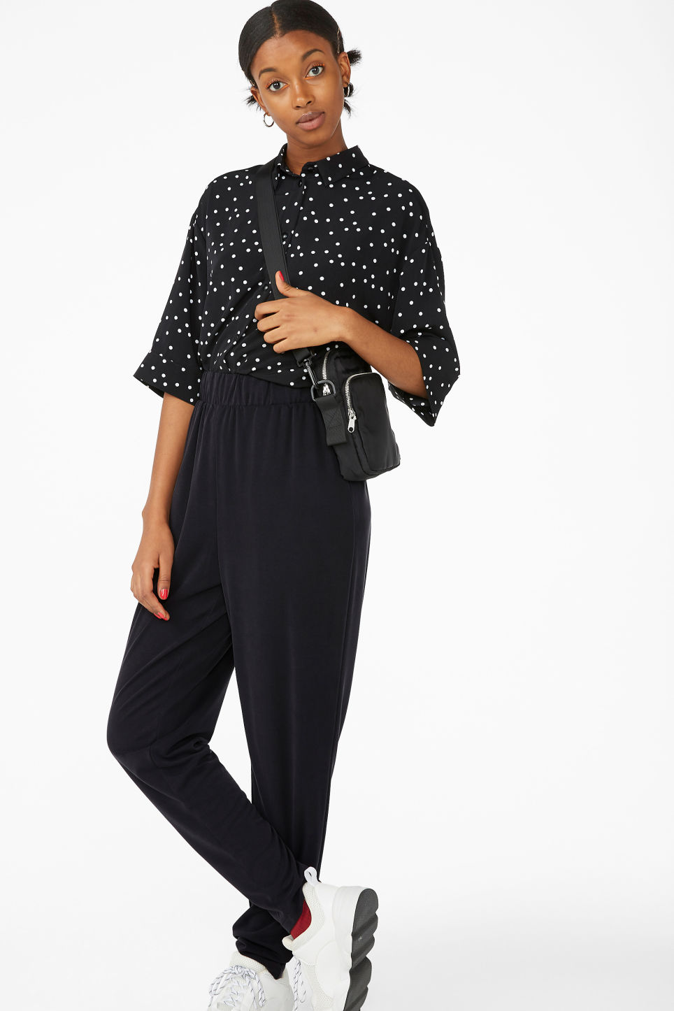 Model side image of Monki flowy oversized shirt in black