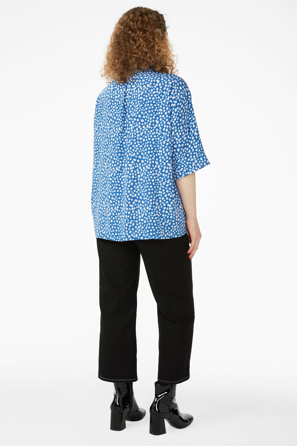 Model back image of Monki oversized button-up blouse in blue