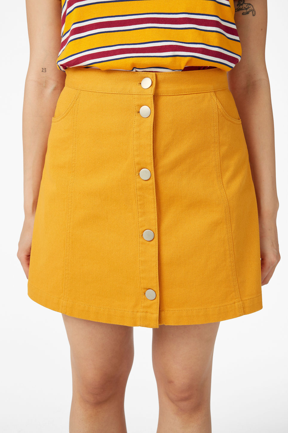 Model side image of Monki mini skirt in yellow
