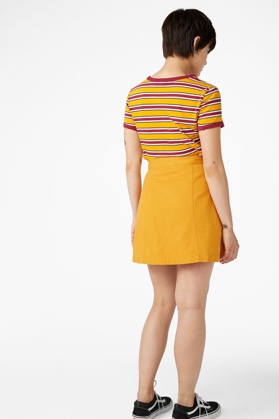 Model back image of Monki mini skirt in yellow