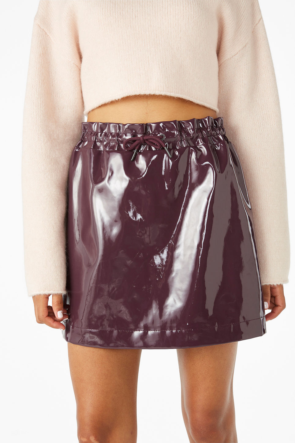 Model front image of Monki patent mini skirt in pink
