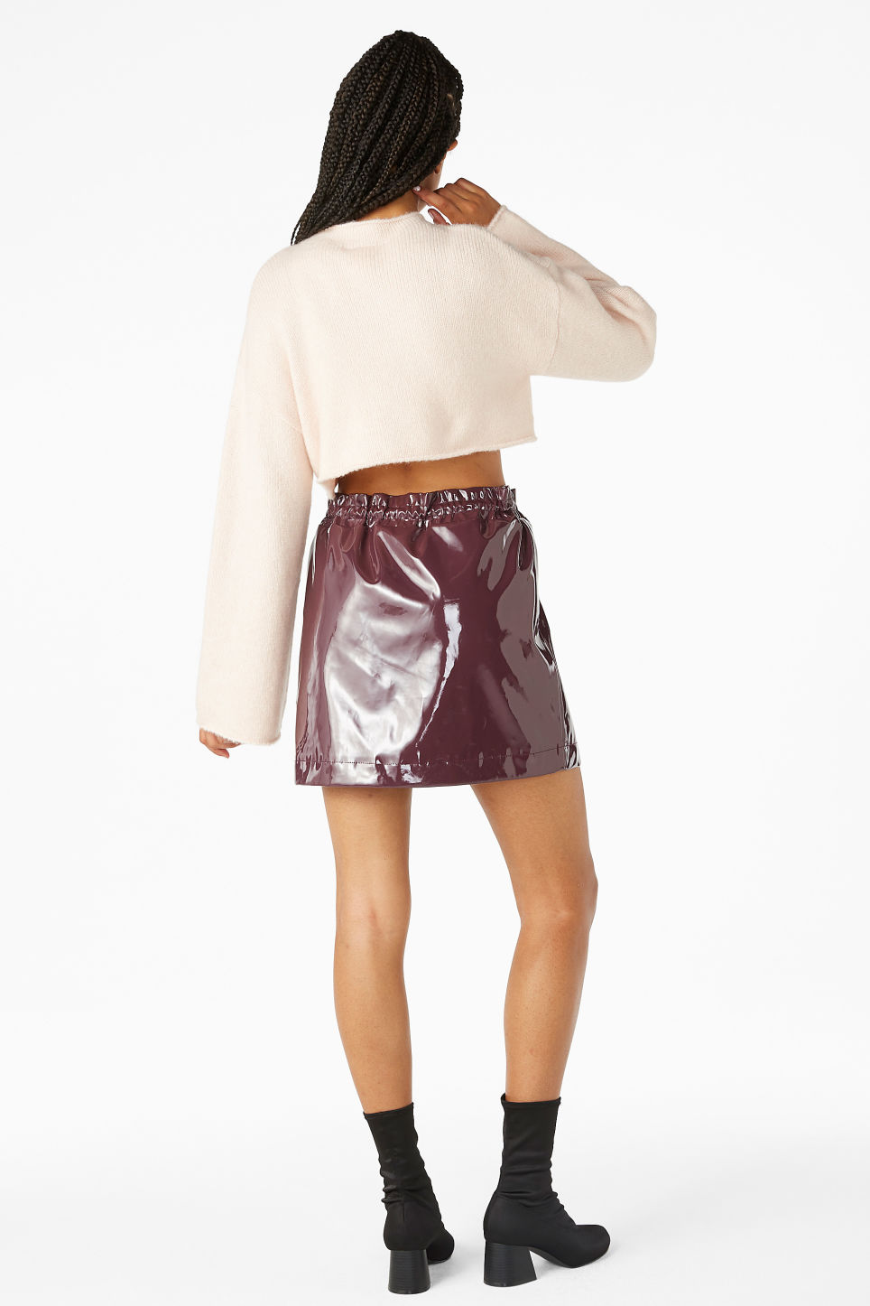 Model back image of Monki patent mini skirt in pink
