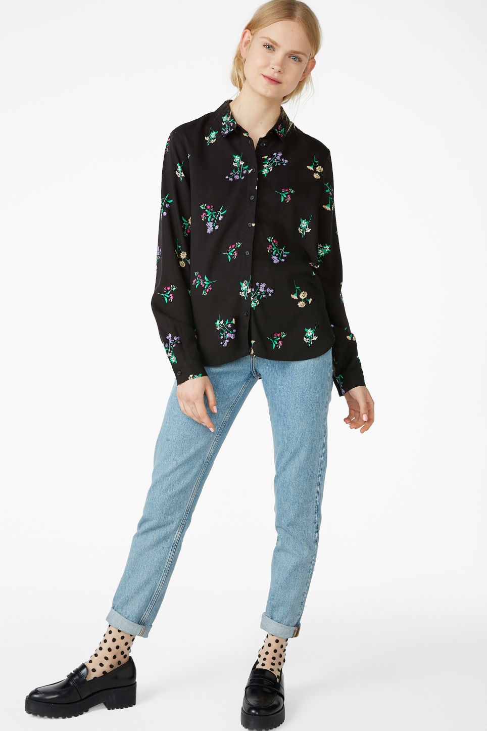 Model side image of Monki soft button up blouse in black