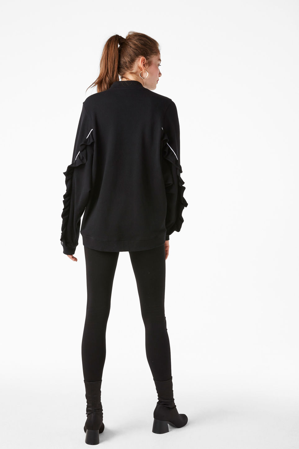 Model back image of Monki zip ruffle jacket in black