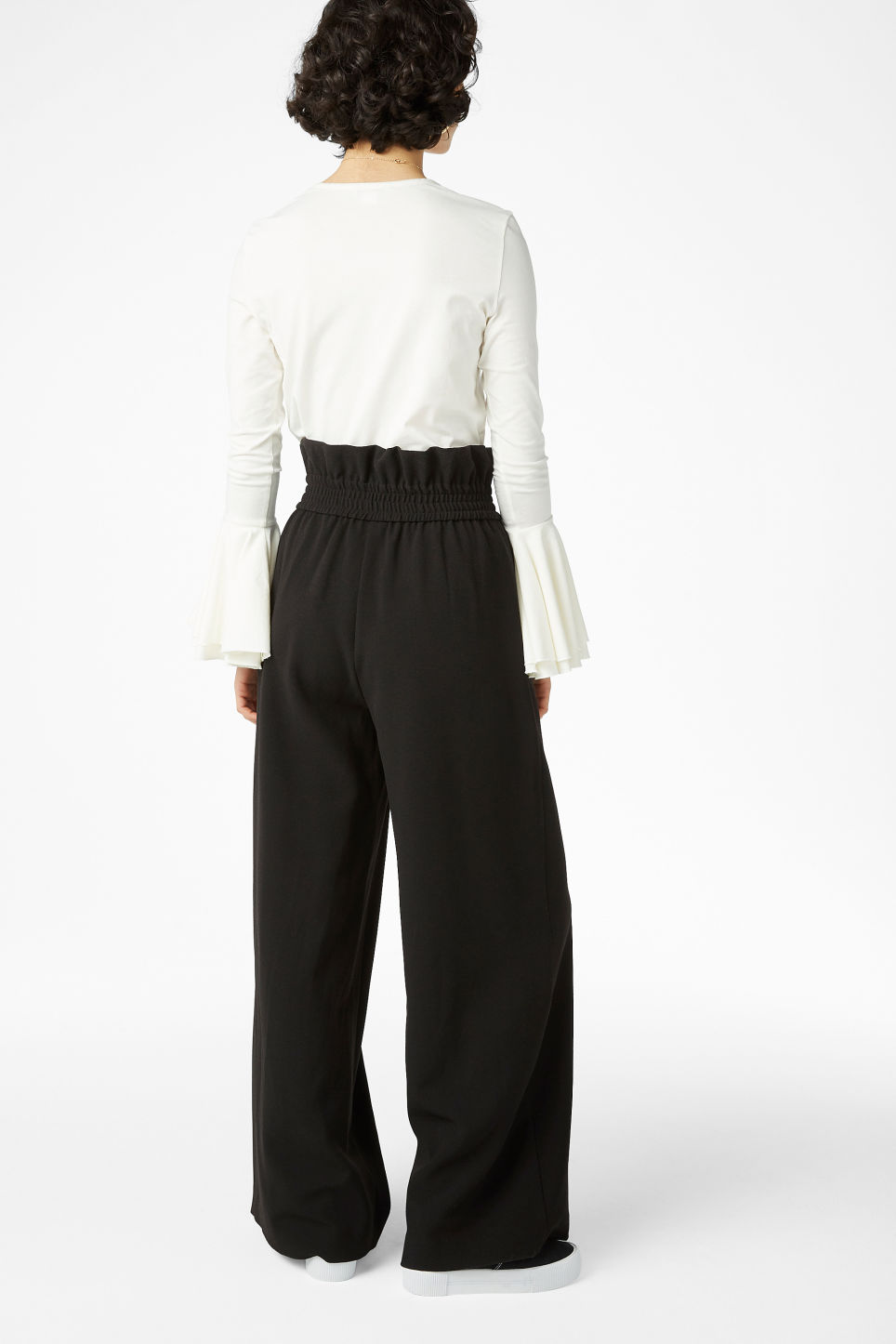 Model back image of Monki wide trousers in black