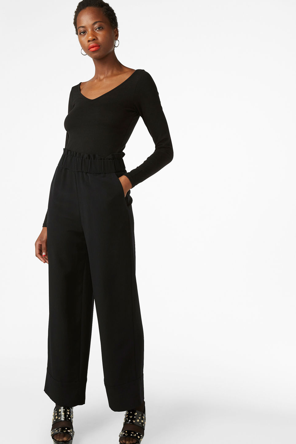 Model front image of Monki v neck top in black