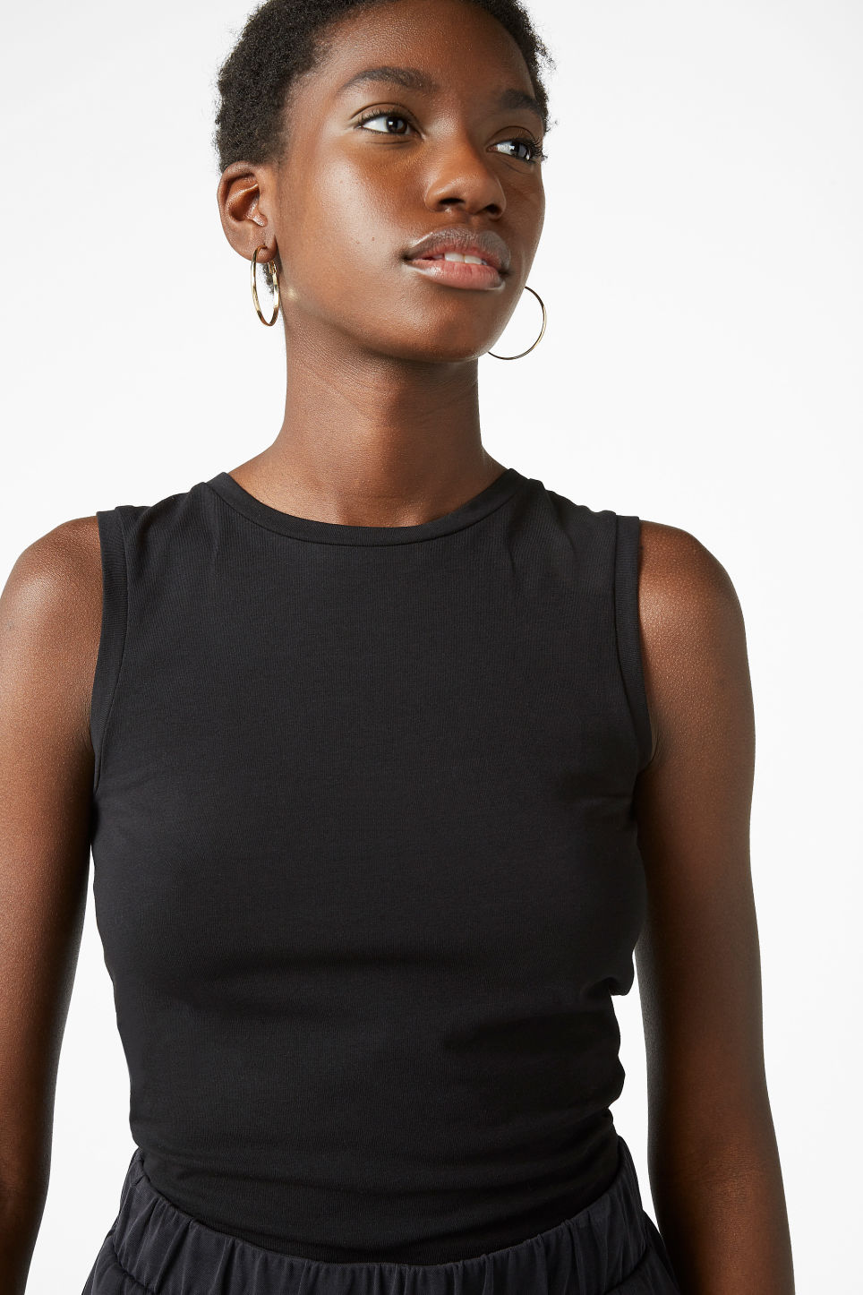 Model front image of Monki stretchy singlet in black