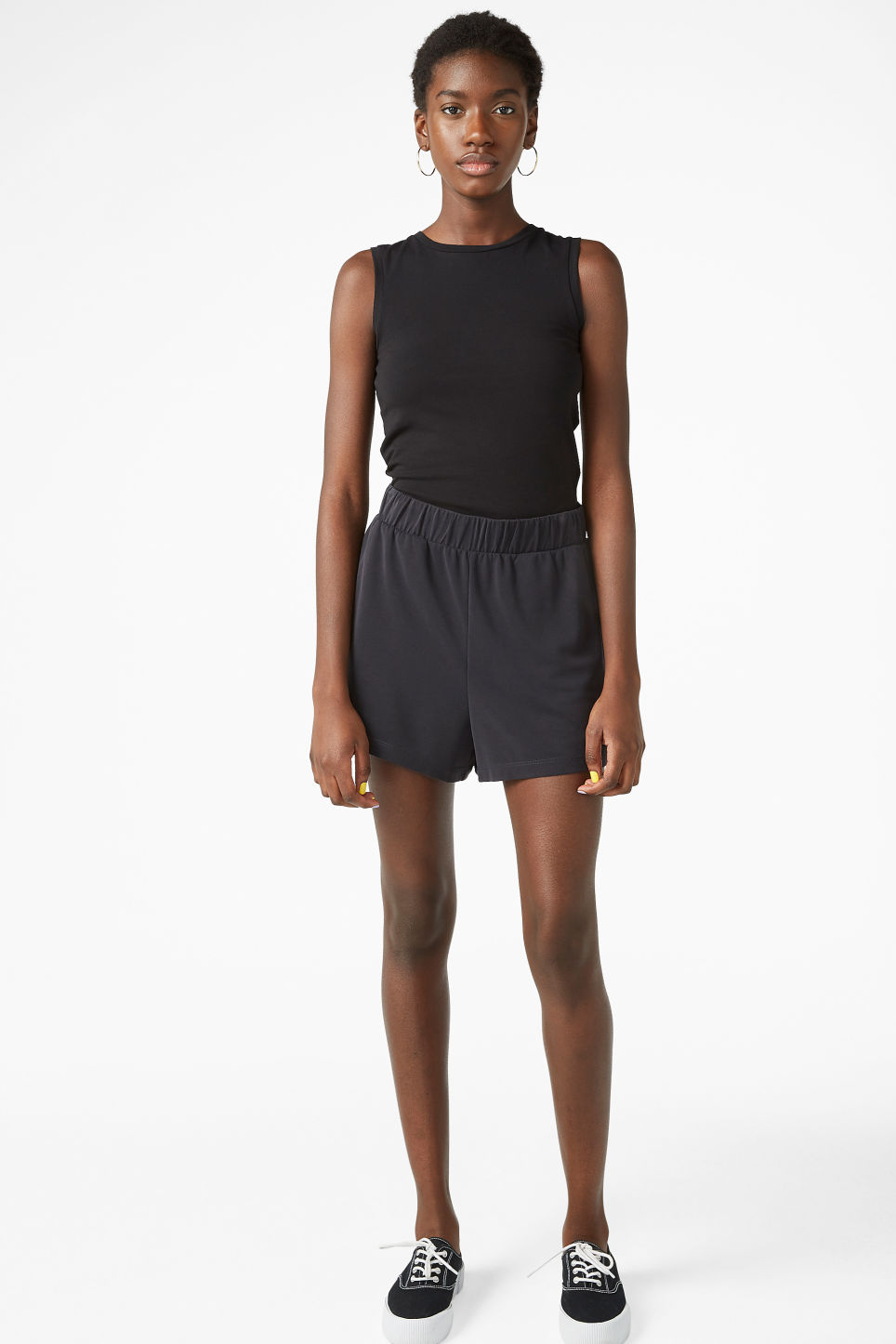 Model side image of Monki stretchy singlet in black