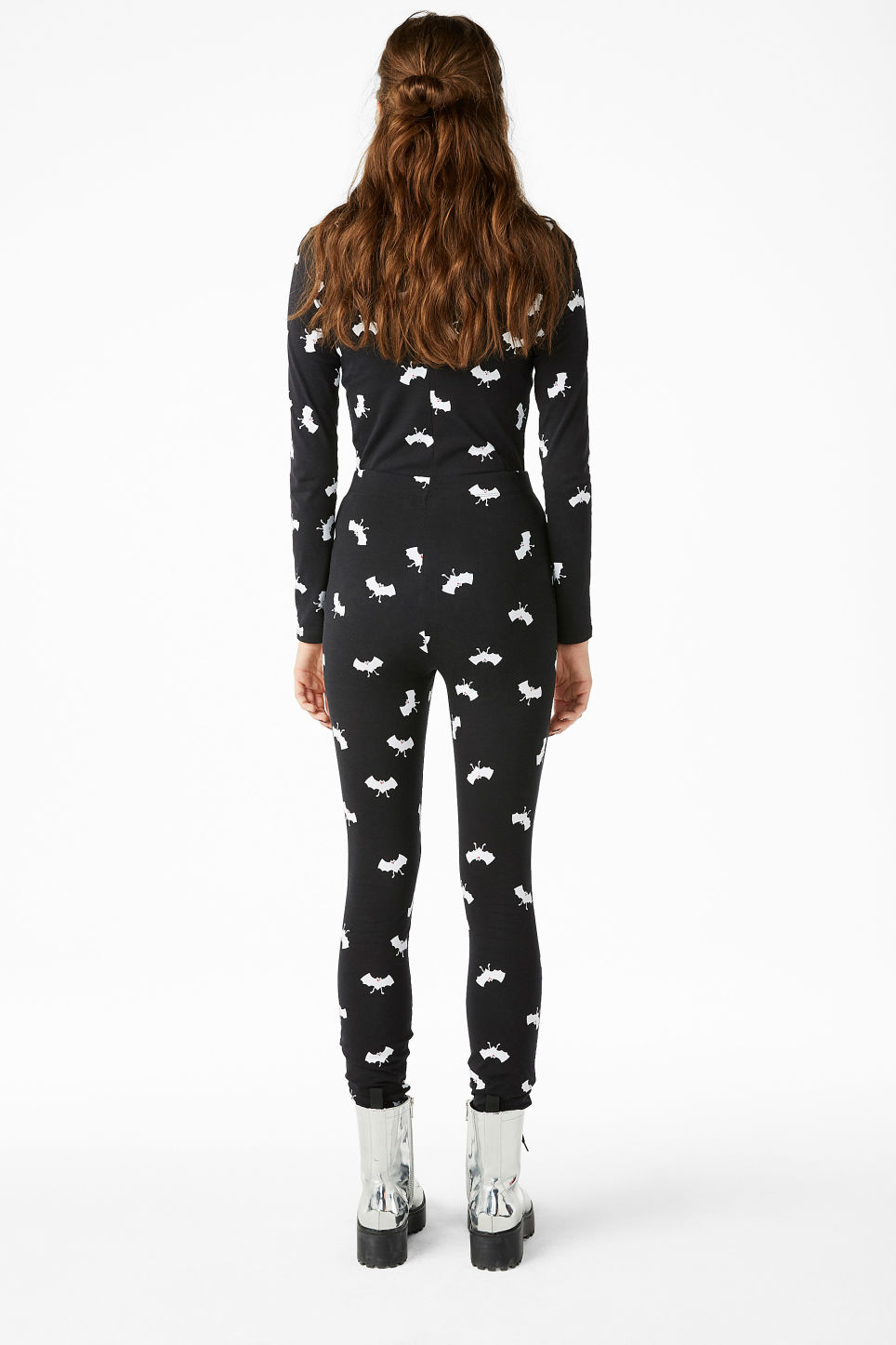 Model back image of Monki statement leggings in black