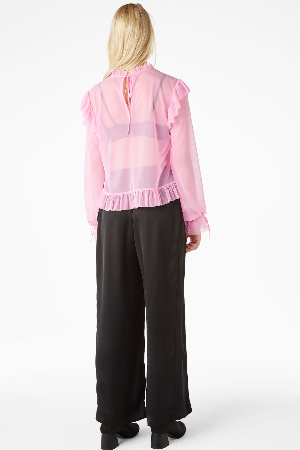 Model back image of Monki sheer ruffle blouse in pink