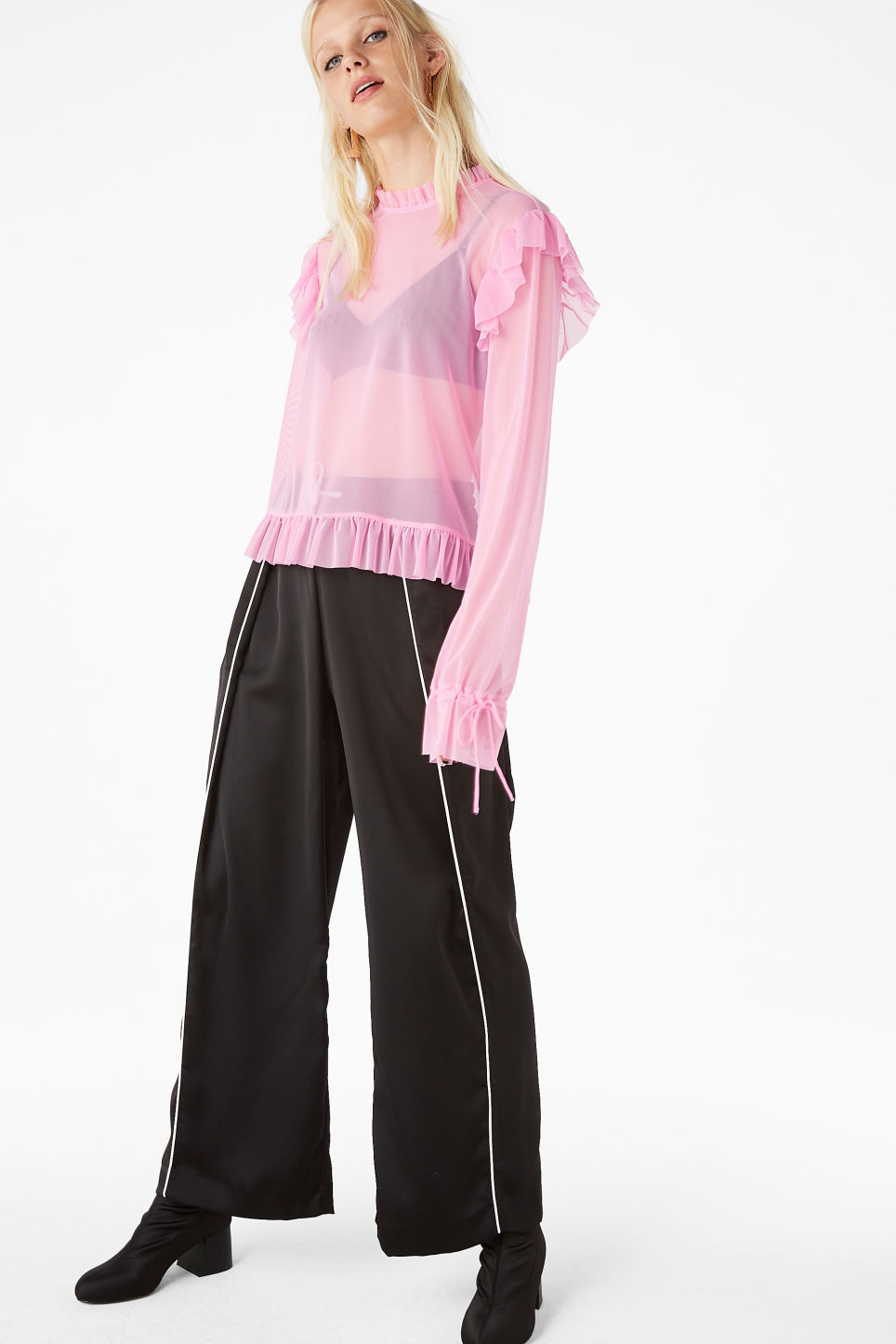 Model side image of Monki sheer ruffle blouse in pink