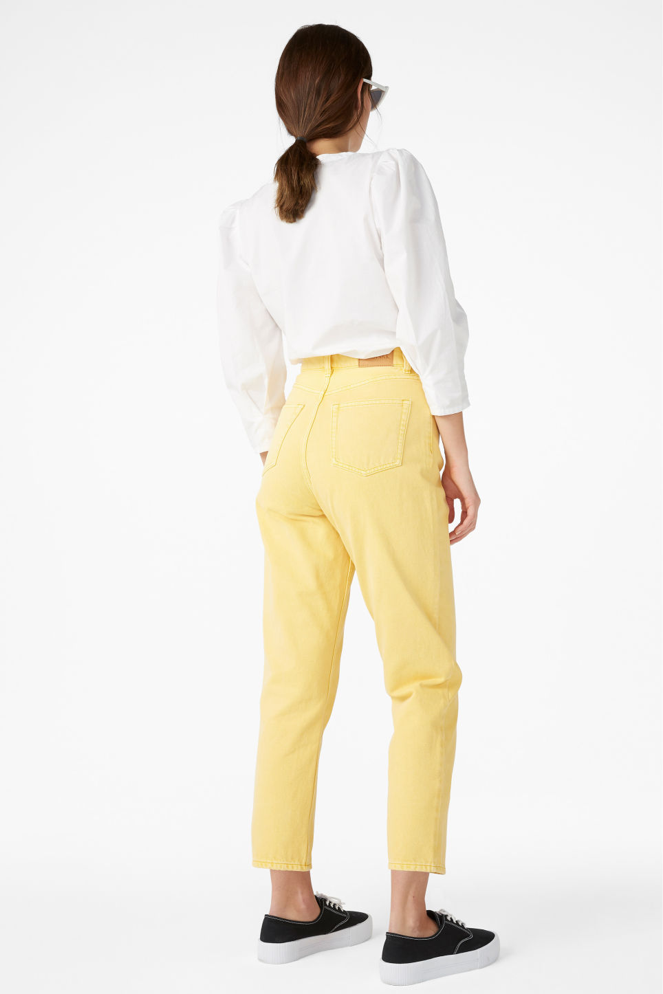 Model back image of Monki taiki jeans in yellow