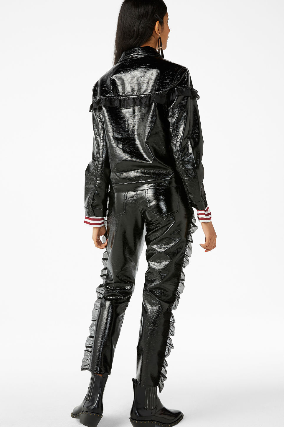 Model back image of Monki patent faux leather jacket in black