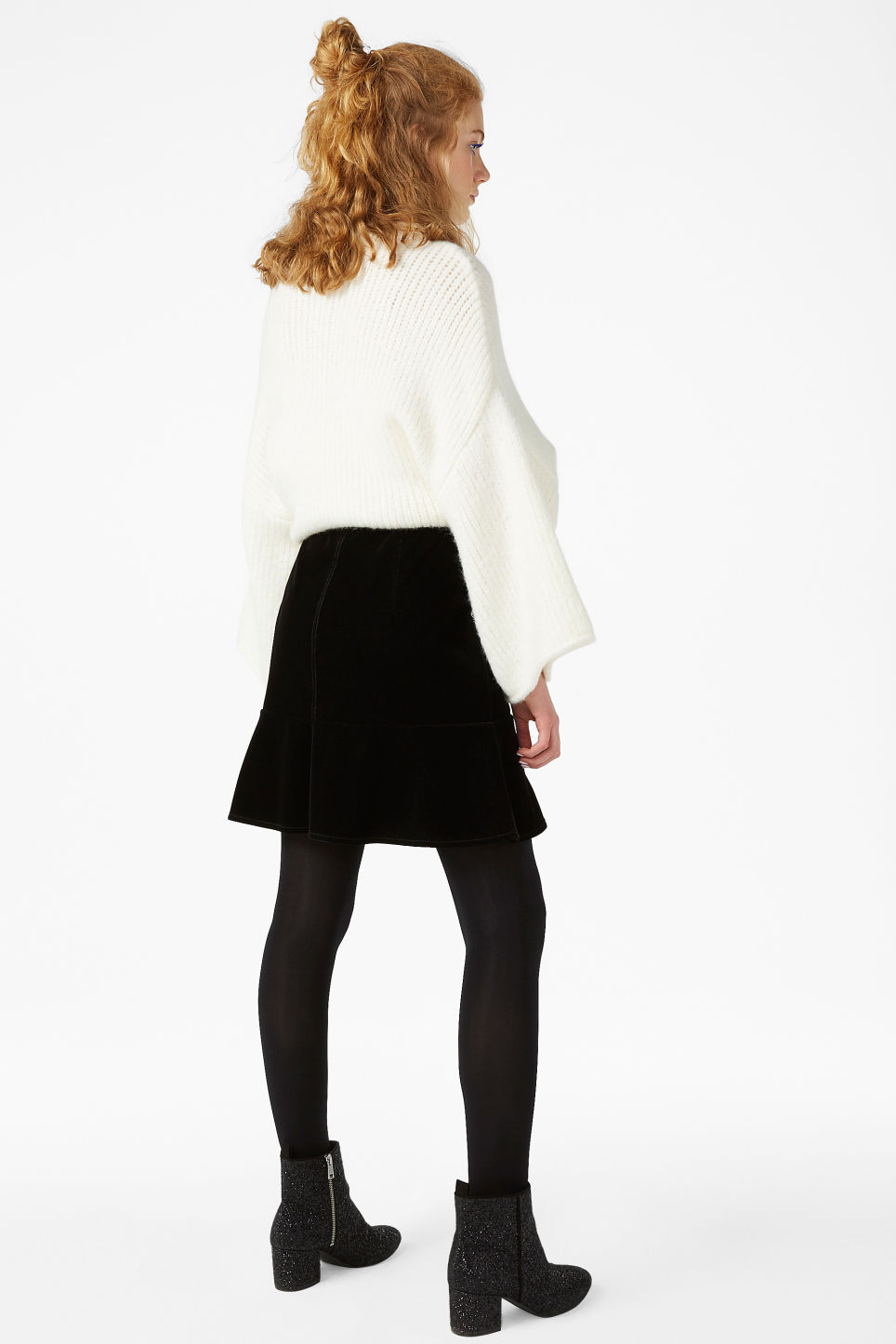 Model back image of Monki velvet skirt in black