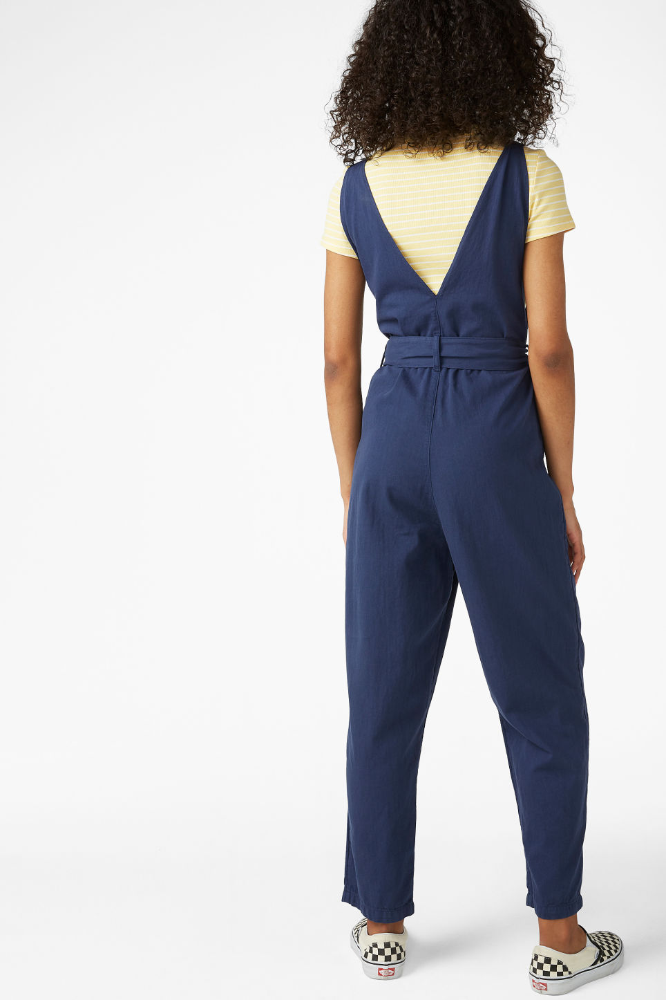 Model back image of Monki denim jumpsuit in blue
