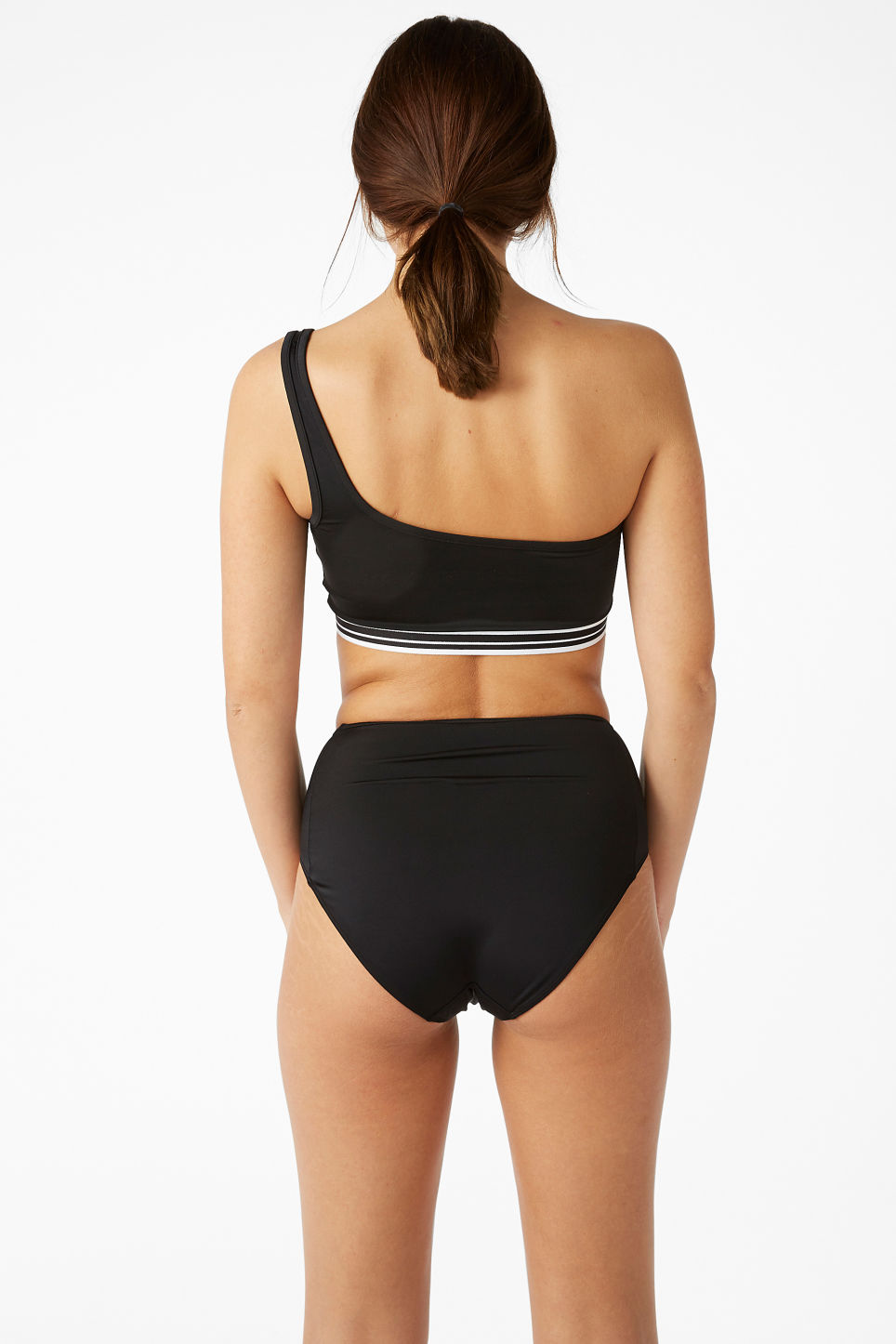 Model back image of Monki one shoulder bikini top in black
