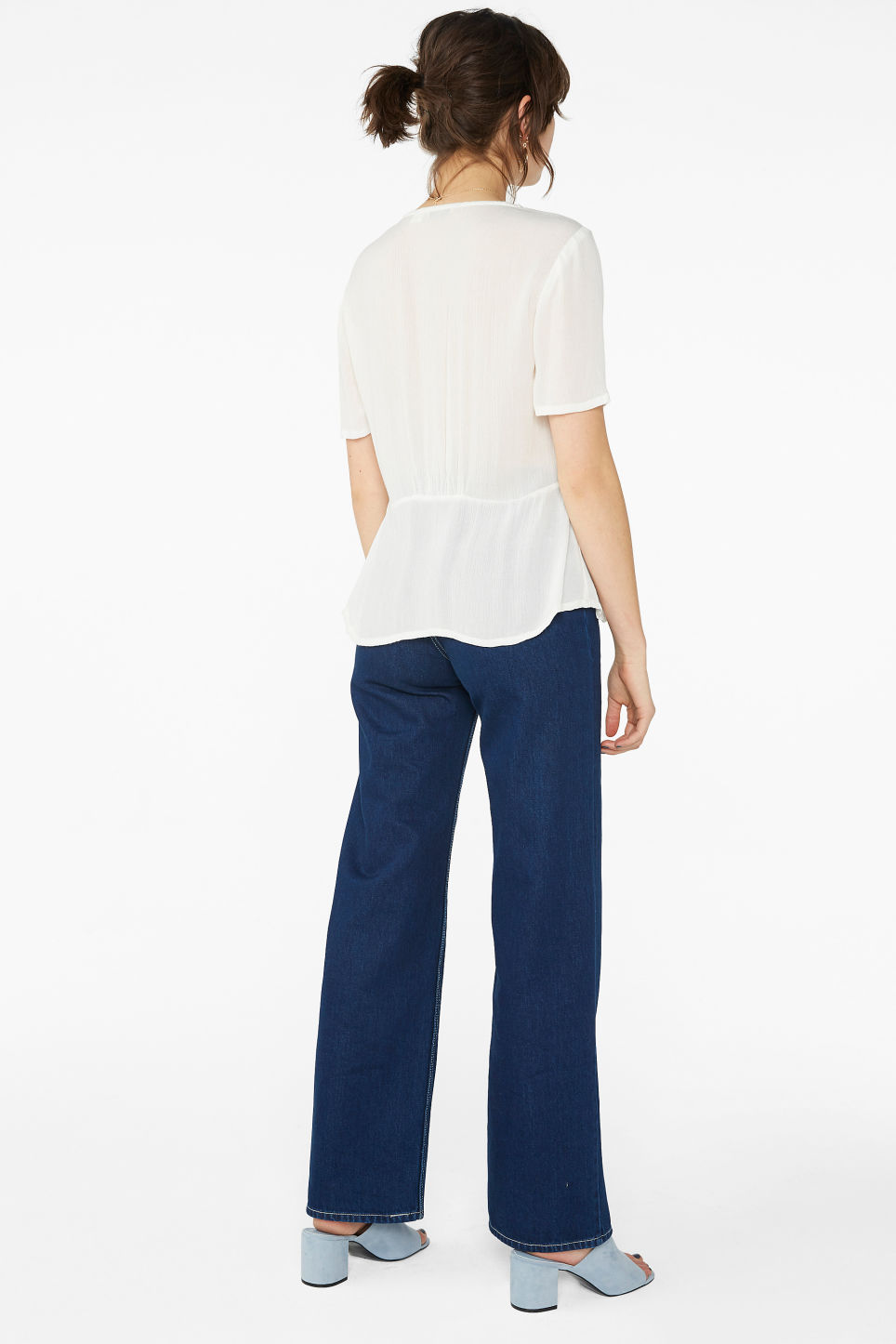 Model back image of Monki v-neck blouse in white