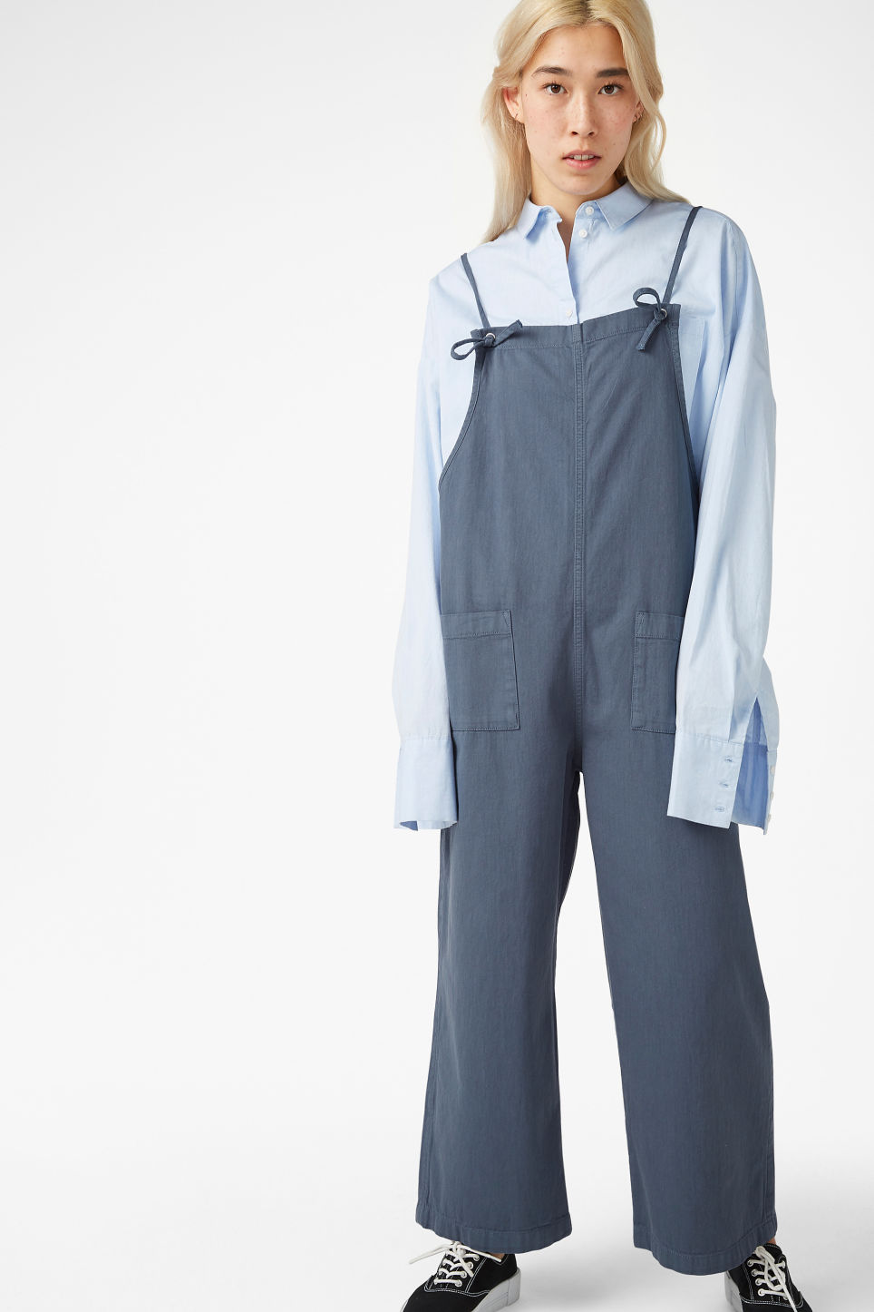 Model front image of Monki denim dungarees in blue