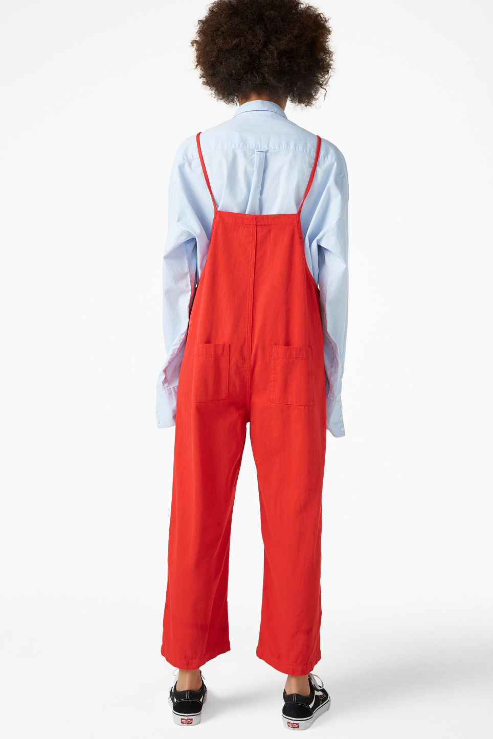 Model back image of Monki denim dungarees in red