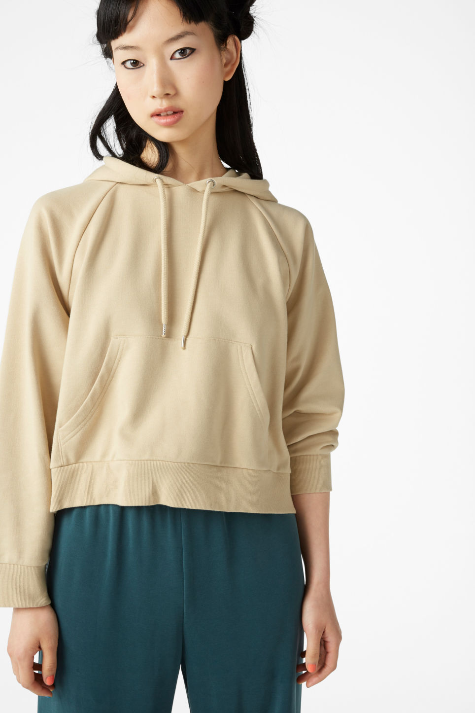 Model front image of Monki cropped hoodie in beige