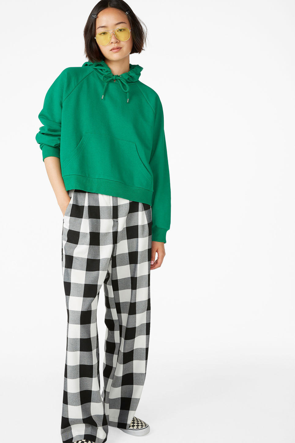 Model side image of Monki cropped hoodie in green
