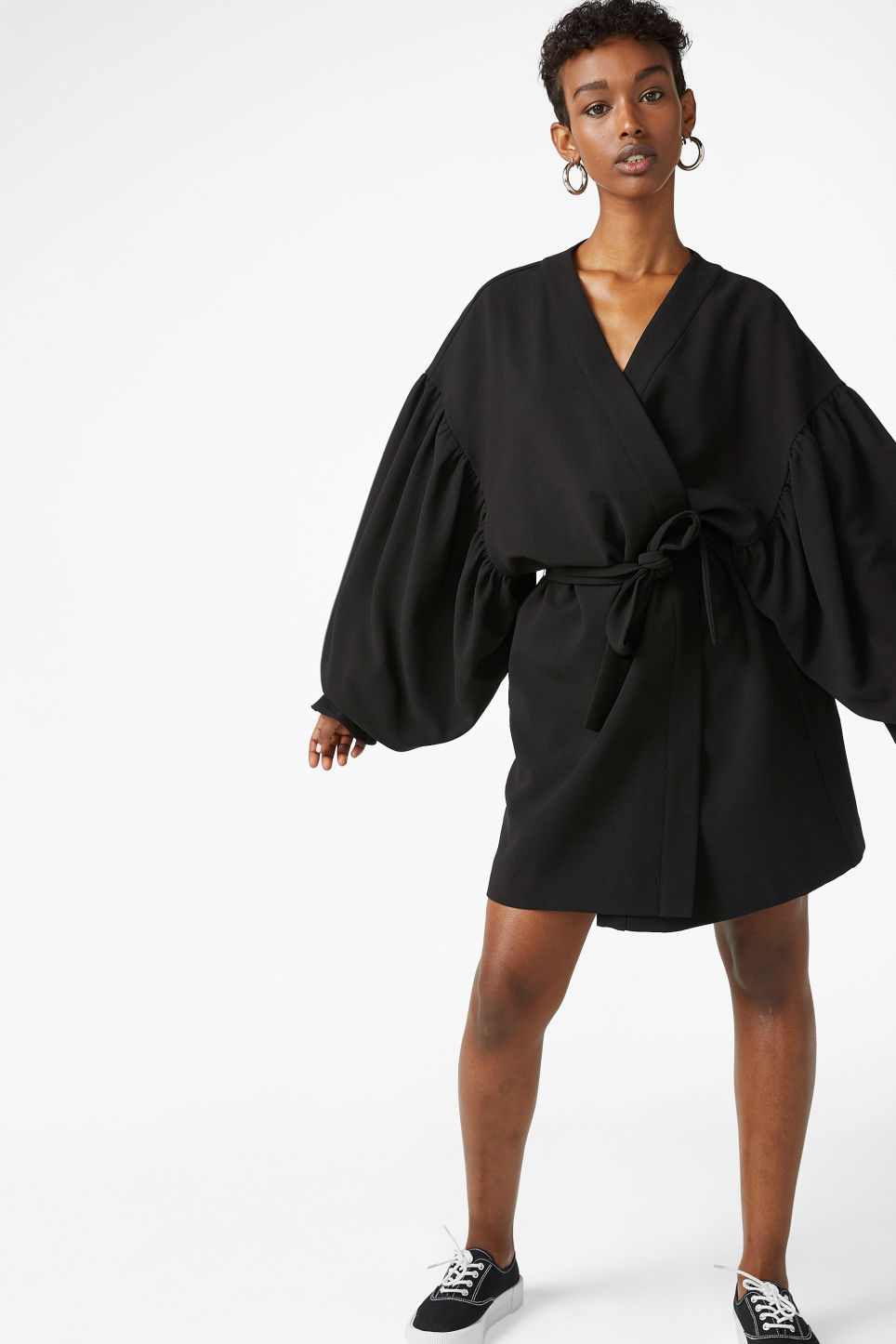 Model side image of Monki kimono-style blouse in black