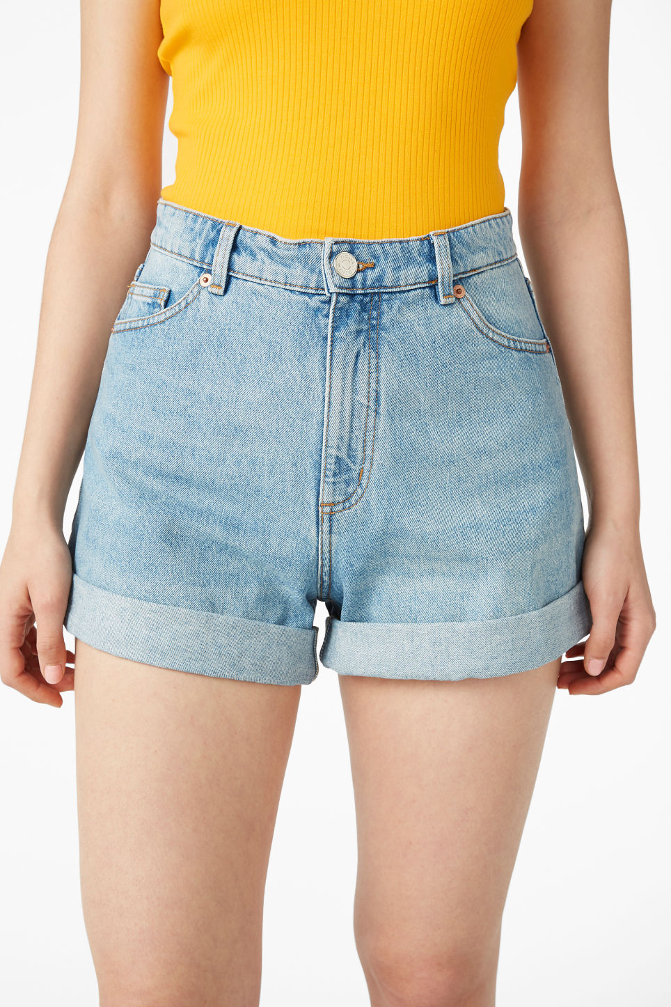 Model side image of Monki denim shorts in blue