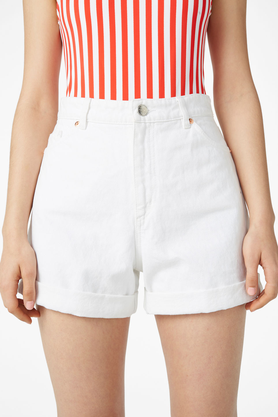 Model side image of Monki denim shorts in white
