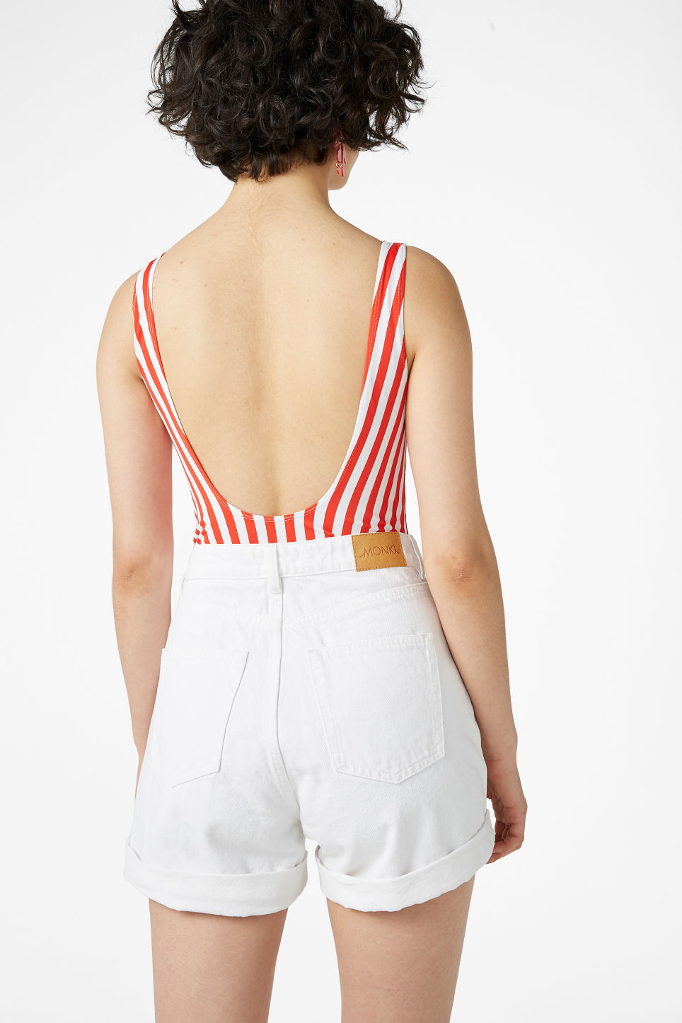 Model back image of Monki denim shorts in white
