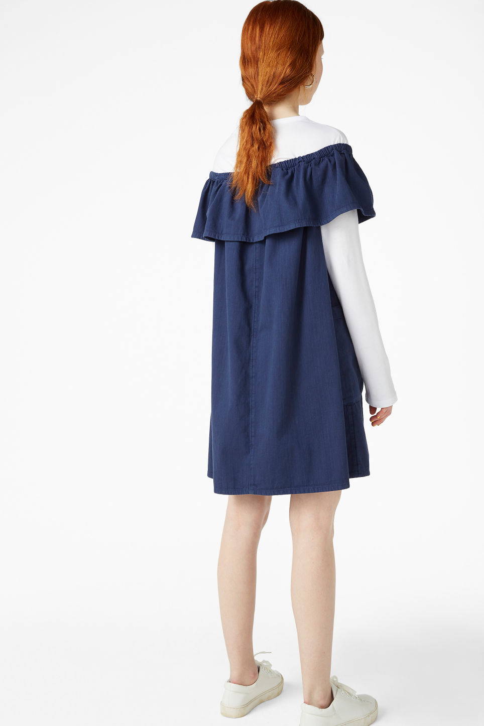 Model back image of Monki ruffled denim dress in blue