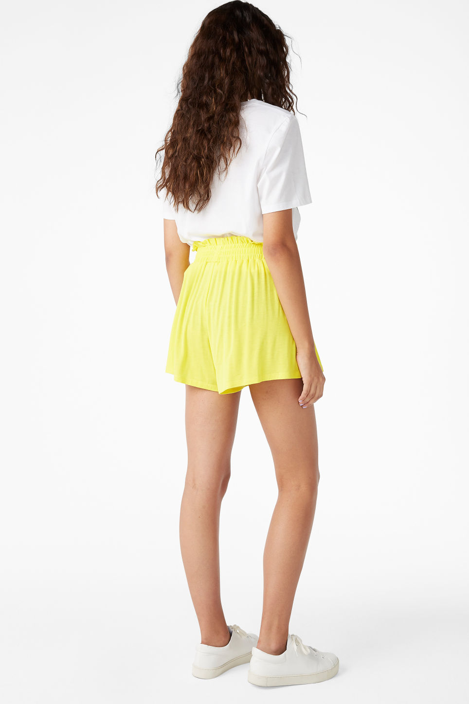 Model back image of Monki soft shorts in yellow
