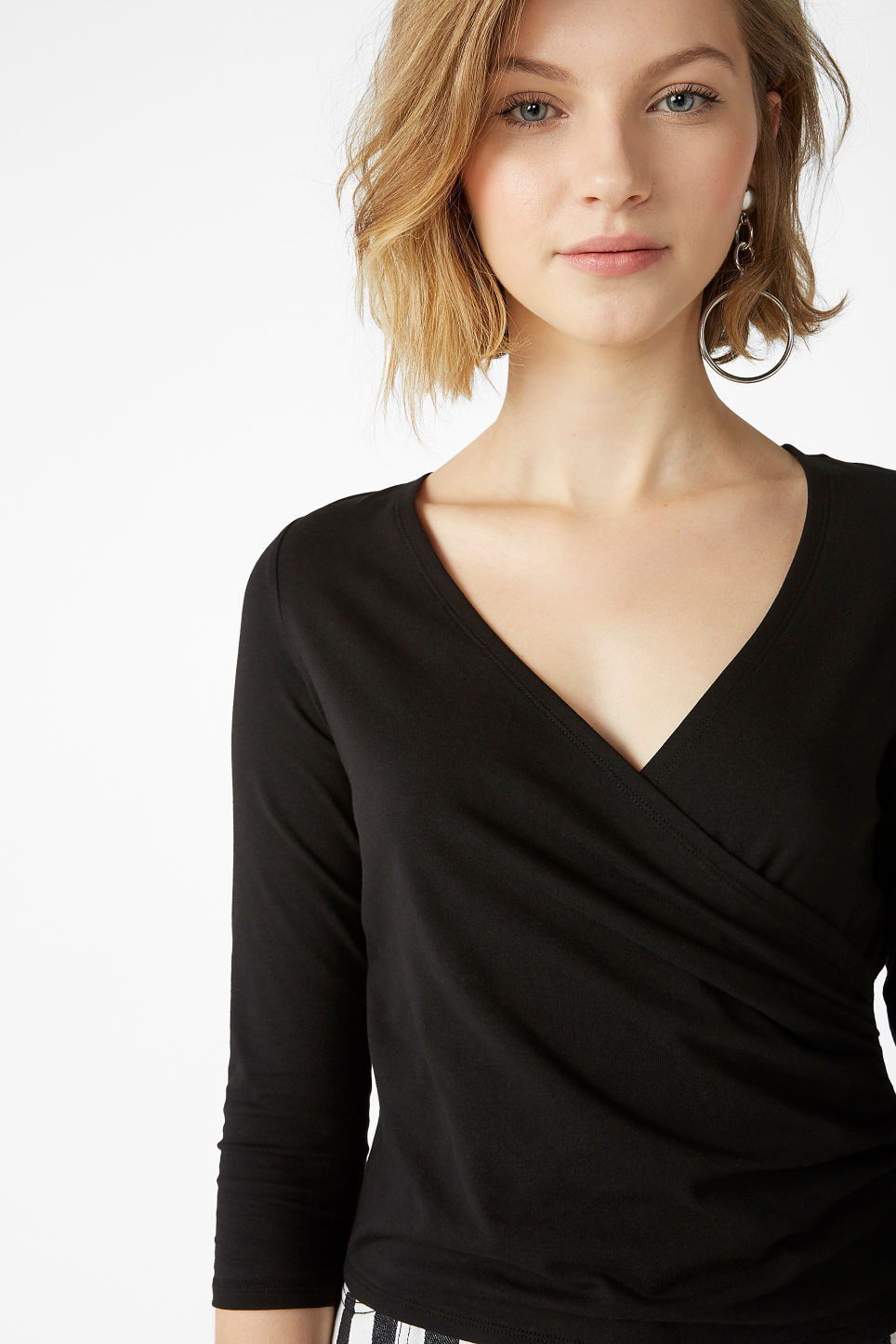 Model front image of Monki cotton wrap top in black