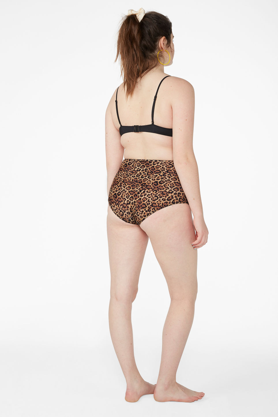 Model back image of Monki high-waisted bikini briefs in yellow