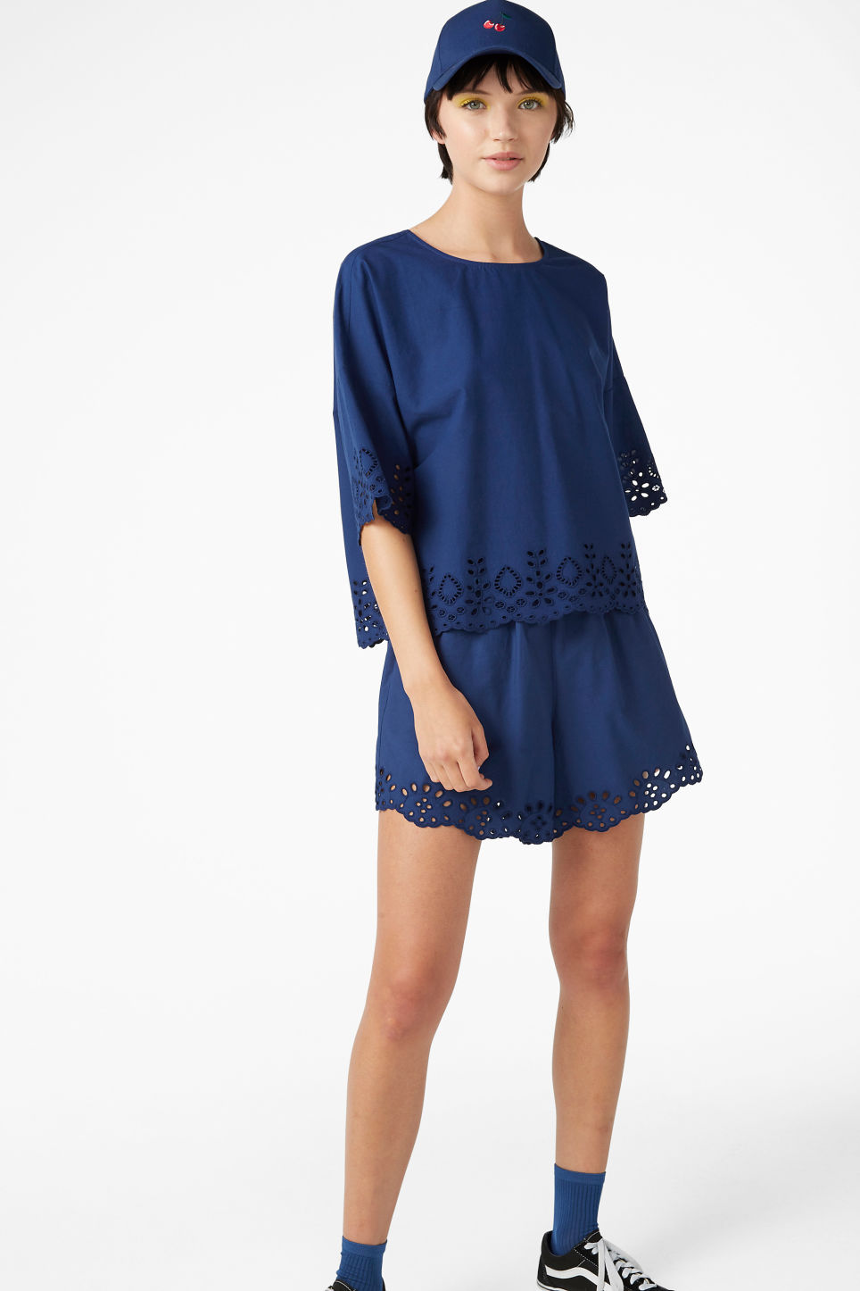 Model side image of Monki flowy blouse in blue