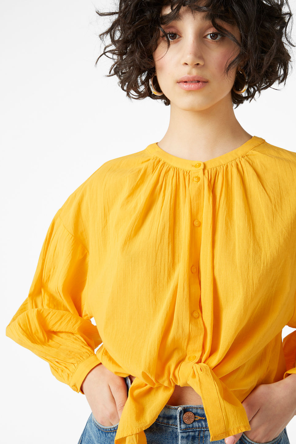 Model front image of Monki button up blouse in yellow