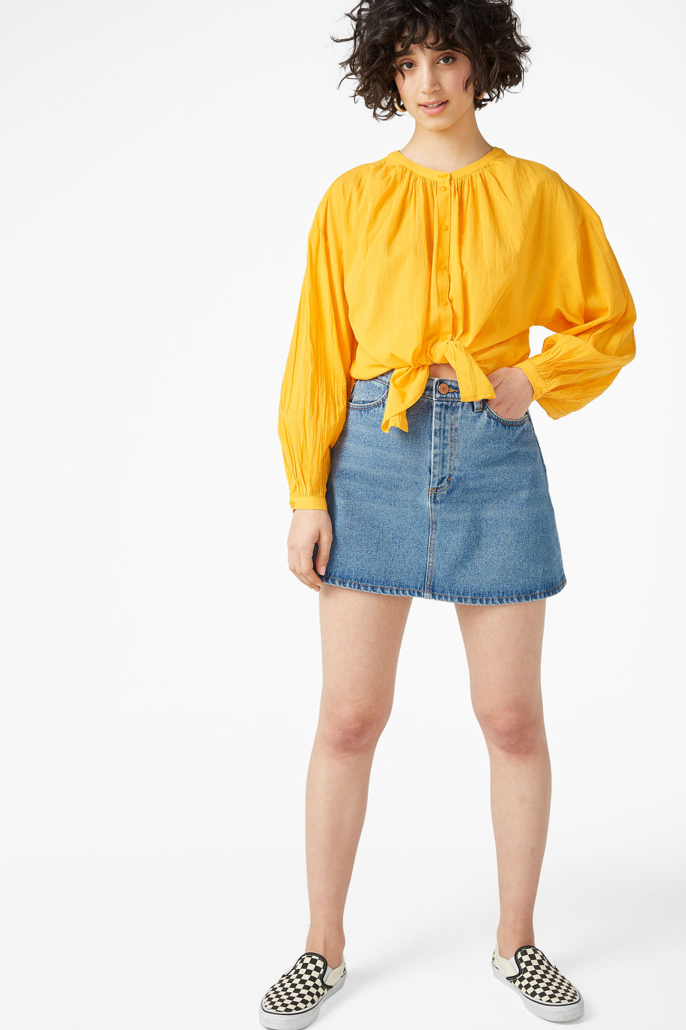 Model side image of Monki button up blouse in yellow
