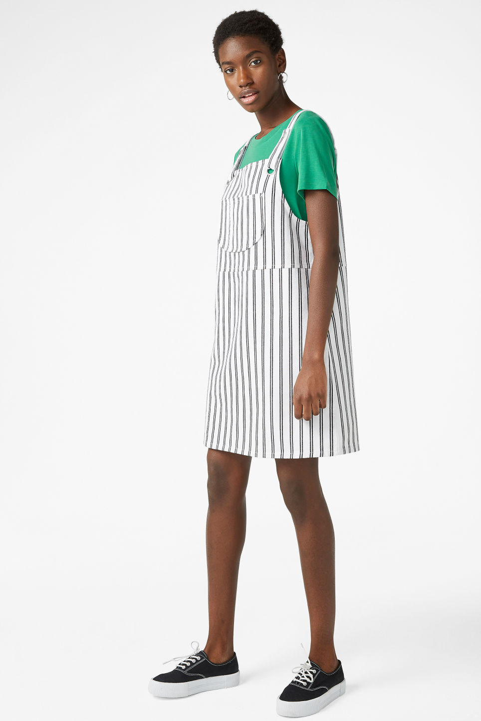 Model side image of Monki dungaree dress in white